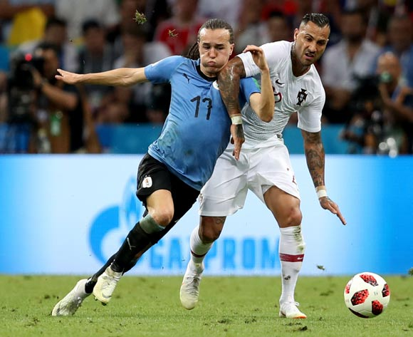 epa06853464 LRicardo Quaresma of Portugal (R) and Cristhian Stuani of Uruguay in action during the FIFA World Cup 2018 round of 16 soccer match between Uruguay and Portugal in Sochi, Russia, 30 June 2018.