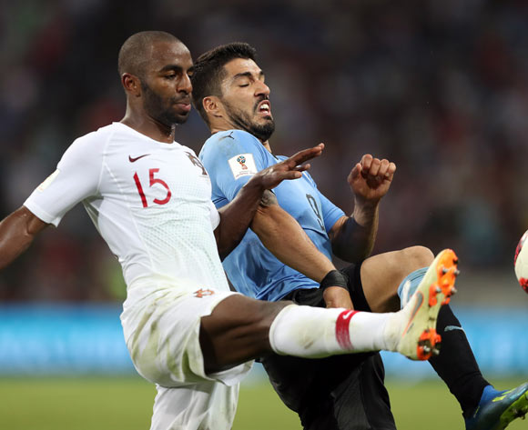 epa06853469 Luis Suarez of Uruguay (R) and Ricardo of Portugal in action during the FIFA World Cup 2018 round of 16 soccer match between Uruguay and Portugal in Sochi, Russia, 30 June 2018.