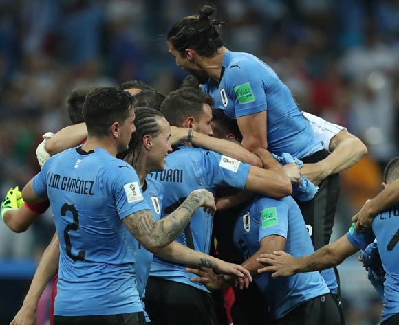 epa06853475 Players of Uruguay celebrate after the FIFA World Cup 2018 round of 16 soccer match between Uruguay and Portugal in Sochi, Russia, 30 June 2018. Uruguay won the match 2-1.