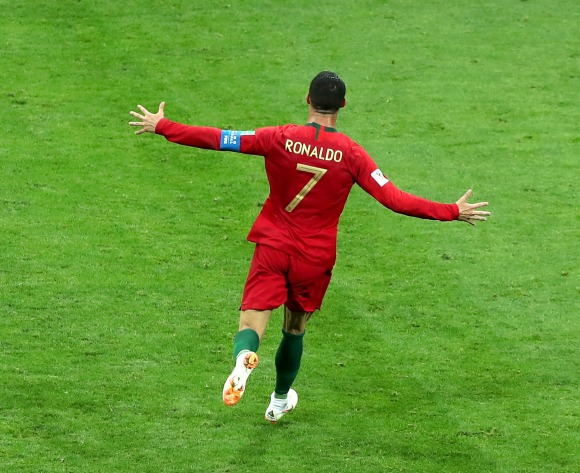 Ronaldo hat-trick earns Portugal share of the spoils against Spain