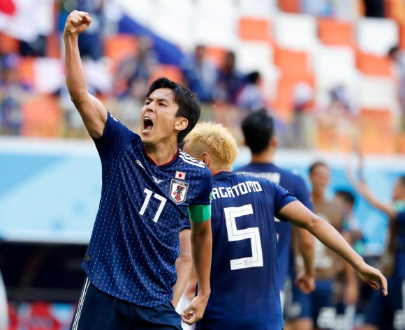 Japan off to a bright start in Group H after beating ten-man Colombia