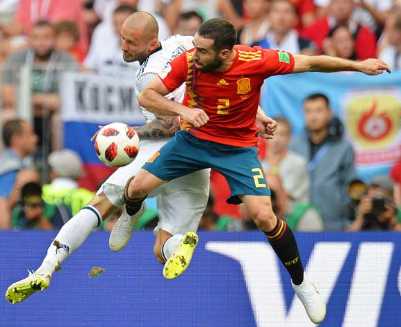 epa06855546 Dani Carvajal (R) of Spain in action against Fedor Kudryashov (L) of Russia during the FIFA World Cup 2018 round of 16 soccer match between Spain and Russia in Moscow, Russia, 01 July 2018.