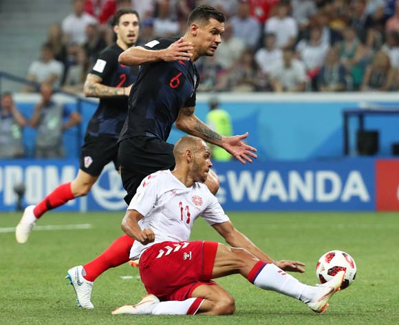 epa06856239 Dejan Lovren (C) of Croatia in action against Martin Braithwaite (R) of Denmark during the FIFA World Cup 2018 round of 16 soccer match between Croatia and Denmark in Nizhny Novgorod, Russia, 01 July 2018.