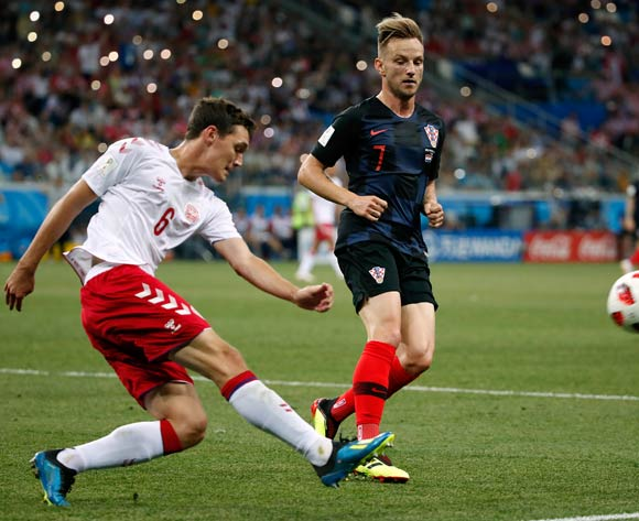 epa06856254 Ivan Rakitic of Croatia (R) and Andreas Christensen of Denmark in action during the FIFA World Cup 2018 round of 16 soccer match between Croatia and Denmark in Nizhny Novgorod, Russia, 01 July 2018.