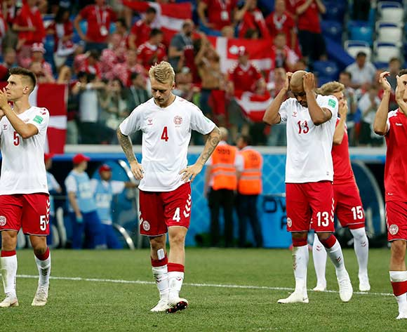 epa06856735 Simon Kjaer of Denmark (C) and teammates react after the FIFA World Cup 2018 round of 16 soccer match between Croatia and Denmark in Nizhny Novgorod, Russia, 01 July 2018.