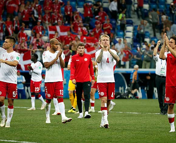 epa06856736 Simon Kjaer of Denmark (C) and teammates react after the FIFA World Cup 2018 round of 16 soccer match between Croatia and Denmark in Nizhny Novgorod, Russia, 01 July 2018.