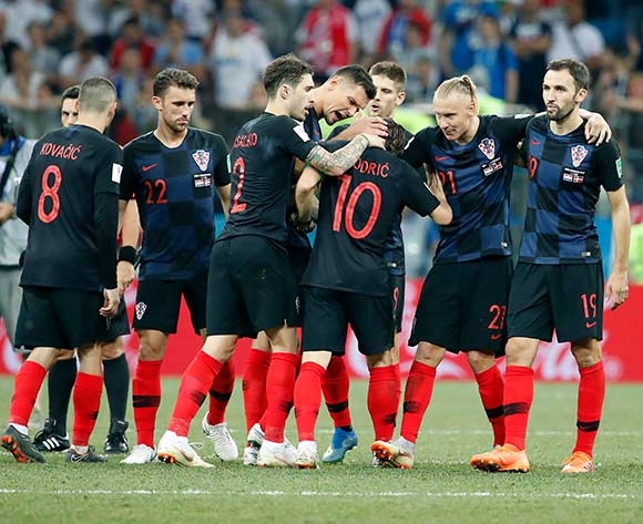 Players of Croatia react after Luka Modric (C) scored the penalty shootout  after the FIFA World Cup 2018 round of 16 soccer match between Croatia and Denmark in Nizhny Novgorod, Russia, 01 July 2018.
