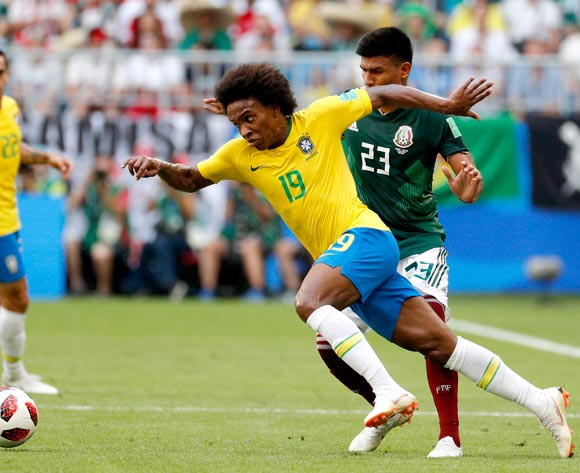 epa06858100 Jesus Gallardo of Mexico (R) and Willian of Brazil in action during the FIFA World Cup 2018 round of 16 soccer match between Brazil and Mexico in Samara, Russia, 02 July 2018.