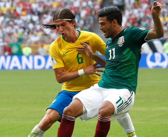 epa06858103 Filipe Luis (L) of Brazil and Carlos Vela of Mexico in action during the FIFA World Cup 2018 round of 16 soccer match between Brazil and Mexico in Samara, Russia, 02 July 2018.
