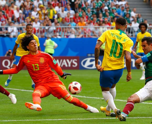 epa06858148 Goalkeeper Guillermo Ochoa (C) of Mexico clears the ball during the FIFA World Cup 2018 round of 16 soccer match between Brazil and Mexico in Samara, Russia, 02 July 2018.
