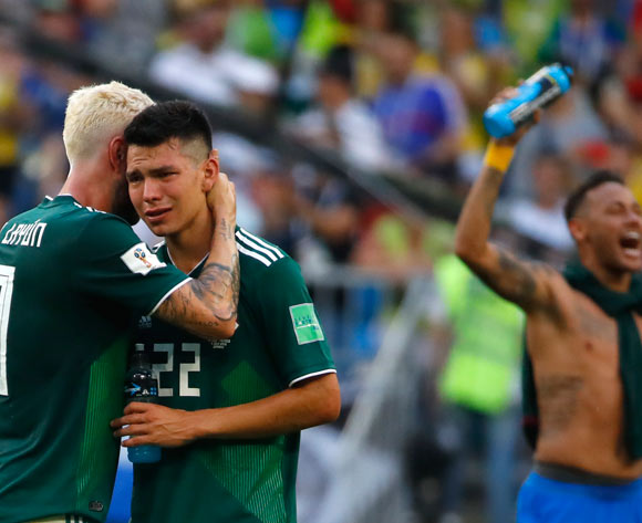 epa06858517 Hirving Lozano (2nd L) of Mexico reacts next to Neymar (R) of Brazil after the FIFA World Cup 2018 round of 16 soccer match between Brazil and Mexico in Samara, Russia, 02 July 2018.