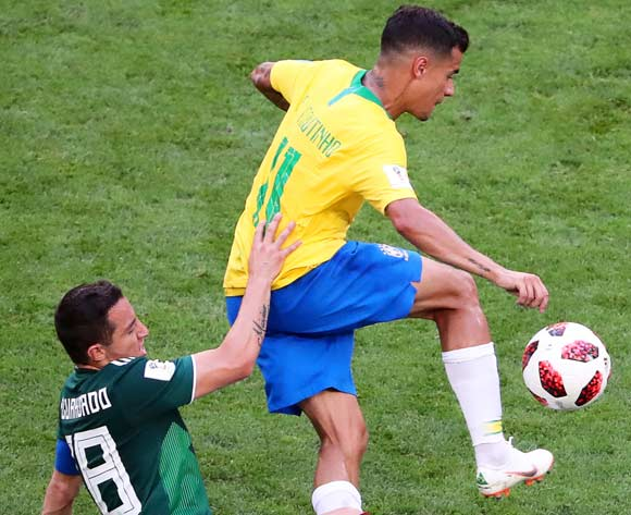 epa06858535 Andres Guardado (L) of Mexico in action against Philippe Coutinho (L) of Brazil during the FIFA World Cup 2018 round of 16 soccer match between Brazil and Mexico in Samara, Russia, 02 July 2018. Brazil won 2-0.