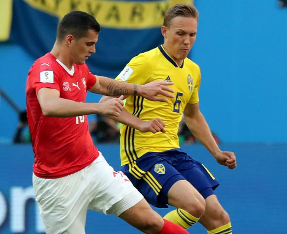 epa06861048 Ludwig Augustinsson of Sweden (R) and Granit Xhaka of Switzerland in action during the FIFA World Cup 2018 round of 16 soccer match between Sweden and Switzerland in St.Petersburg, Russia, 03 July 2018.