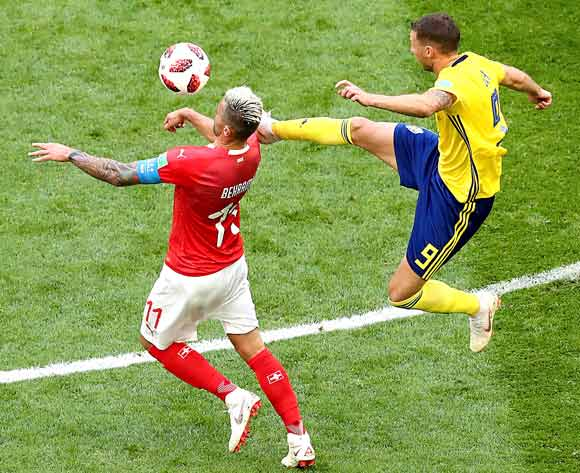 epa06861049 Marcus Berg of Sweden (R) and Valon Behrami of Switzerland in action during the FIFA World Cup 2018 round of 16 soccer match between Sweden and Switzerland in St.Petersburg, Russia, 03 July 2018.