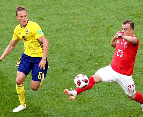 epa06861071 Xherdan Shaqiri of Switzerland (R) and Ludwig Augustinsson of Sweden in action during the FIFA World Cup 2018 round of 16 soccer match between Sweden and Switzerland in St.Petersburg, Russia, 03 July 2018.