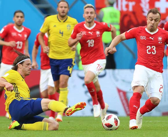 Gustav Svensson (L) of Sweden and Xherdan Shaqiri of Switzerland in action during the FIFA World Cup 2018 round of 16 soccer match between Sweden and Switzerland in St.Petersburg, Russia, 03 July 2018.