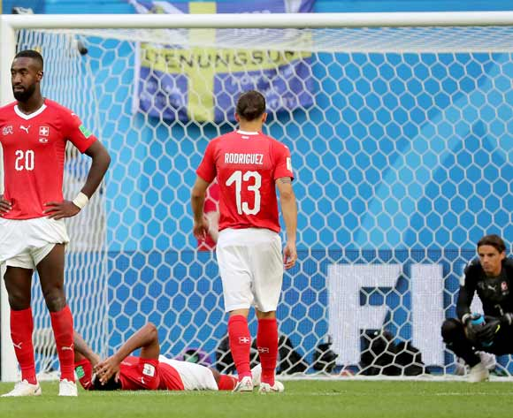 epa06861443 Players of Switzerland react after the FIFA World Cup 2018 round of 16 soccer match between Sweden and Switzerland in St.Petersburg, Russia, 03 July 2018.