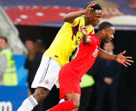 epa06861958 Raheem Sterling (R) of England in action against Yerry Mina (L) of Colombia during the FIFA World Cup 2018 round of 16 soccer match between Colombia and England in Moscow, Russia, 03 July 2018.