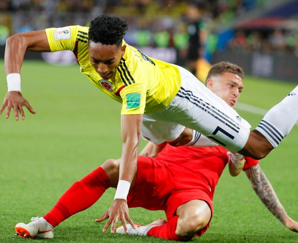 epa06861975 Johan Mojica (up) of Colombia in action against Kieran Trippier (back) of England during the FIFA World Cup 2018 round of 16 soccer match between Colombia and England in Moscow, Russia, 03 July 2018.