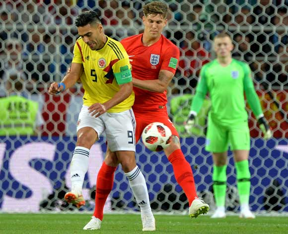 epa06861983 Radamel Falcao (L) of Colombia and John Stones of England in action during the FIFA World Cup 2018 round of 16 soccer match between Colombia and England in Moscow, Russia, 03 July 2018.