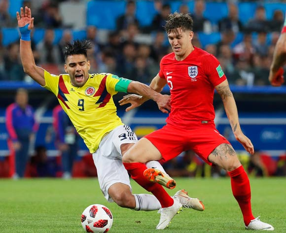 epa06862355 John Stones (R) of England in action against Radamel Falcao (L) of Colombia during the FIFA World Cup 2018 round of 16 soccer match between Colombia and England in Moscow, Russia, 03 July 2018.