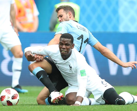 epa06868362 Cristhian Stuani (rear) of Uruguay and Paul Pogba of France in action during the FIFA World Cup 2018 quarter final soccer match between Uruguay and France in Nizhny Novgorod, Russia, 06 July 2018.