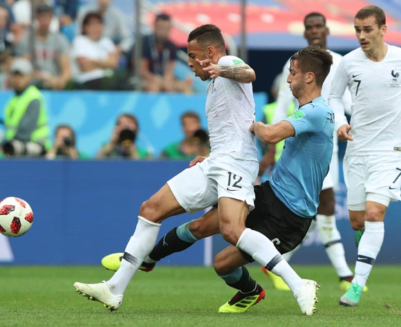 epa06868421 Rodrigo Bentancur (R) of Uruguay fouls Corentin Tolisso of France during the FIFA World Cup 2018 quarter final soccer match between Uruguay and France in Nizhny Novgorod, Russia, 06 July 2018.