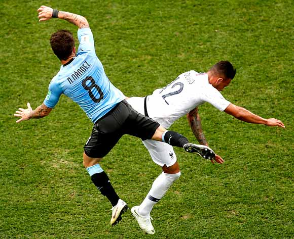 epa06868423 Nahitan Nandez of Uruguay (L) and Corentin Tolisso of France in action during the FIFA World Cup 2018 quarter final soccer match between Uruguay and France in Nizhny Novgorod, Russia, 06 July 2018.