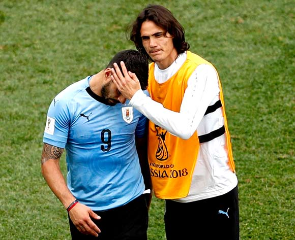 epa06868875 Edinson Cavani of Uruguay (R) and Luis Suarez of Uruguay react after the FIFA World Cup 2018 quarter final soccer match between Uruguay and France in Nizhny Novgorod, Russia, 06 July 2018.