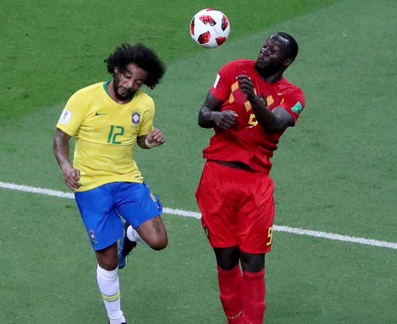 epa06869345 Marcelo (L) of Brazil and Romelu Lukaku of Belgium in action during the FIFA World Cup 2018 quarter final soccer match between Brazil and Belgium in Kazan, Russia, 06 July 2018.