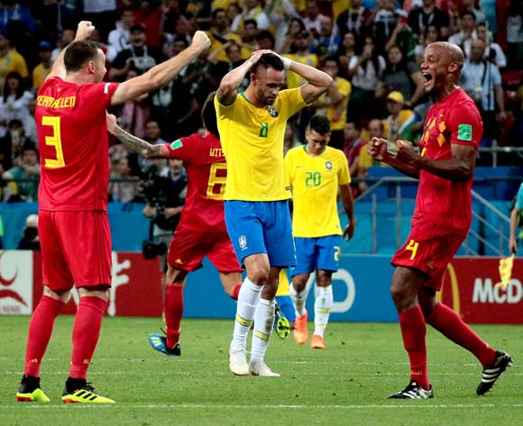 epa06869804 Thomas Vermaelen of Belgium (L) and Vincent Kompany of Belgium (R) celebrate next to Renato Augusto of Brazil (C) after the FIFA World Cup 2018 quarter final soccer match between Brazil and Belgium in Kazan, Russia, 06 July 2018.