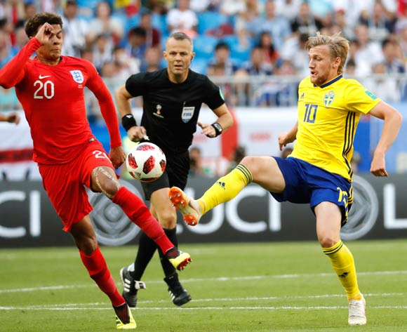 Dele Alli (L) of England and Emil Forsberg of Sweden in action during the FIFA World Cup 2018 quarter final soccer match between Sweden and England in Samara, Russia, 07 July 2018.