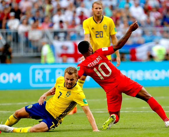 epa06871077 Raheem Sterling of England (R) and Sebastian Larsson of Sweden in action during the FIFA World Cup 2018 quarter final soccer match between Sweden and England in Samara, Russia, 07 July 2018.