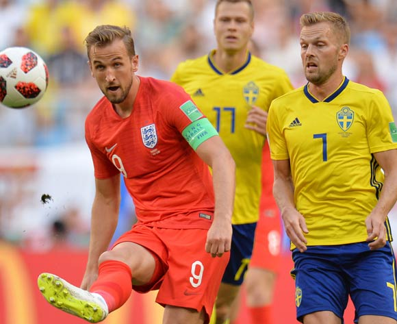 epa06871080 Harry Kane (L) of England and Sebastian Larsson of Sweden in action during the FIFA World Cup 2018 quarter final soccer match between Sweden and England in Samara, Russia, 07 July 2018.