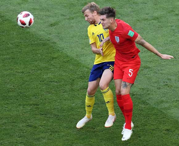 epa06871113 Emil Forsberg of Sweden (back-L) and John Stones of England in action during the FIFA World Cup 2018 quarter final soccer match between Sweden and England in Samara, Russia, 07 July 2018.