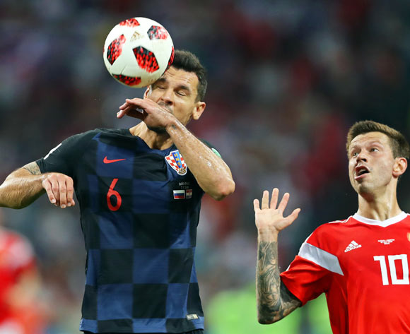 epa06872625 Dejan Lovren (L) of Croatia in action against Fedor Smolov (R) of Russia during the FIFA World Cup 2018 quarter final soccer match between Russia and Croatia in Sochi, Russia, 07 July 2018.