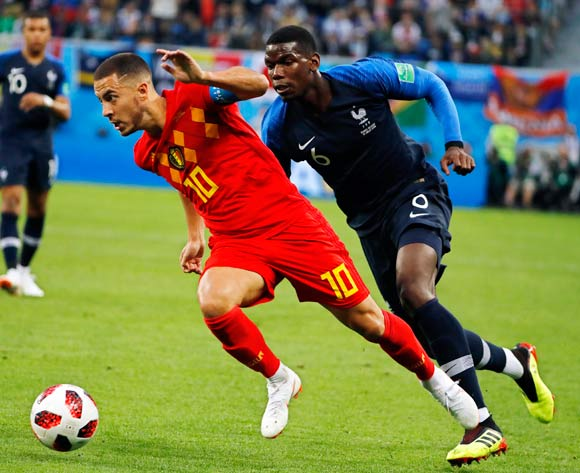 Eden Hazard (L) of Belgium in action against Paul Pogba (R) of France during the FIFA World Cup 2018 semi final soccer match between France and Belgium in St.Petersburg, Russia, 10 July 2018.