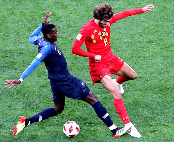 epa06878747 Marouane Fellaini of Belgium (R) and Paul Pogba of France in action during the FIFA World Cup 2018 semi final soccer match between France and Belgium in St.Petersburg, Russia, 10 July 2018.
