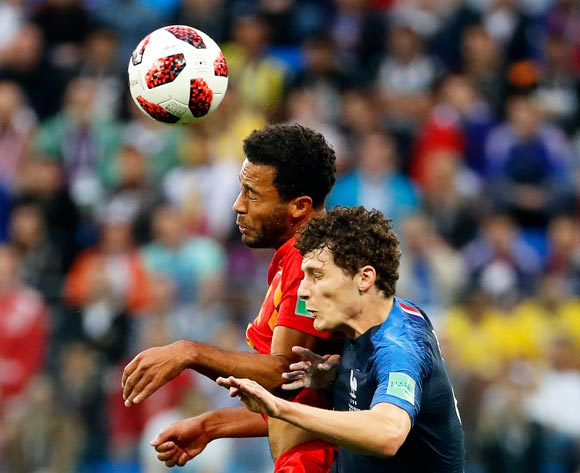 epa06878767 Moussa Dembele (L) of Belgium in action against Benjamin Pavard (R) of France during the FIFA World Cup 2018 semi final soccer match between France and Belgium in St.Petersburg, Russia, 10 July 2018.