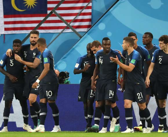 Samuel Umtiti (L)of France celebrates with teammates after scoring the opening goal during the FIFA World Cup 2018 semi final soccer match between France and Belgium in St.Petersburg, Russia, 10 July 2018.