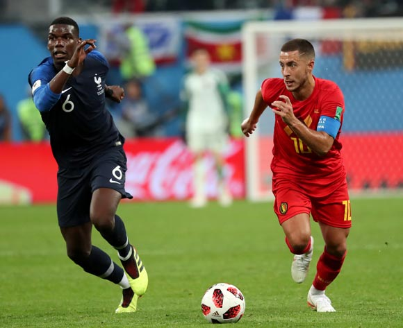 epa06879021 Paul Pogba (L) of France and Eden Hazard of Belgium in action during the FIFA World Cup 2018 semi final soccer match between France and Belgium in St.Petersburg, Russia, 10 July 2018.