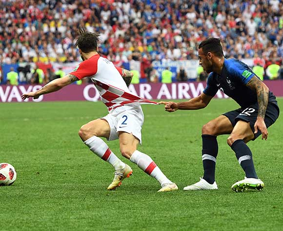 epa06891175 Sime Vrsaljko of Croatia (L) and Corentin Tolisso of France during the FIFA World Cup 2018 final between France and Croatia in Moscow, Russia, 15 July 2018.