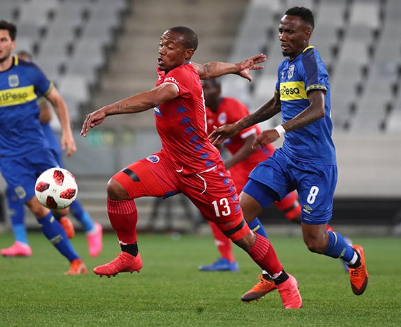 Thuso Phala of Supersport United evades challenge from Teko Modise of Cape Town City FC during the Absa Premiership 2018/19 football match between Cape Town City FC and SuperSport United at Cape Town Stadium, Cape Town on 4 August 2018 ©Chris Ricco/BackpagePix