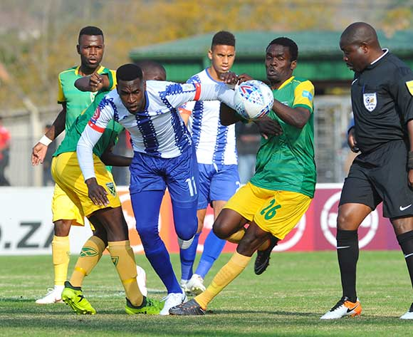 Fortune Makaringe of Maritzburg United is tackled by Danny Phiri of Golden Arrows  during the Absa Premiership match Maritzburg United and Golden Arrows on the 05 August 2018 at Harry Gwala Stadium Pic Sydney Mahlangu/BackpagePix