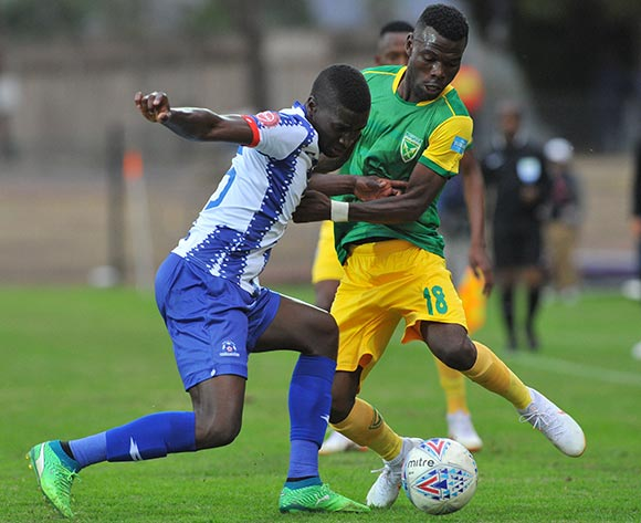 Knox Mutuzwa of Golden Arrows is challenged by Siyanda Xulu of Maritzburg United   during the Absa Premiership match Maritzburg United and Golden Arrows on the 05 August 2018 at Harry Gwala Stadium Pic Sydney Mahlangu/BackpagePix
