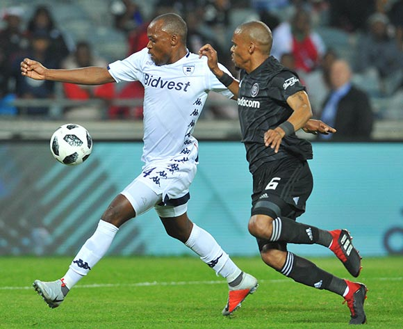 Gladwin Shitolo of Orlando Pirates tackles Gift Motupa of Bidvest Wits during the Absa Premiership match between Orlando Pirates and Bidvest Wits on the 15 August 2018 at Orlando Stadium Pic Sydney Mahlangu/BackpagePix