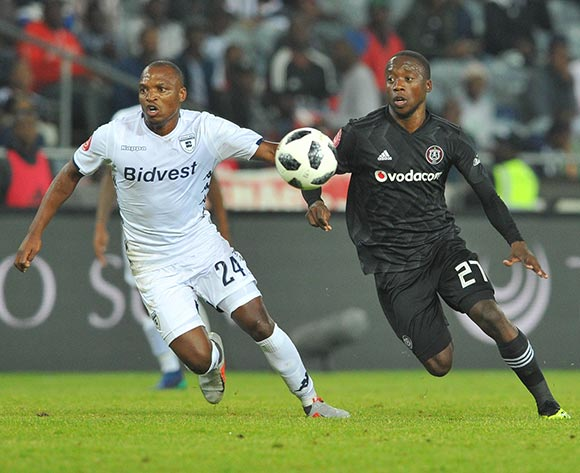 Ben Motshwari of Orlando Pirates tackles Gift Motupa of Bidvest Wits during the Absa Premiership match between Orlando Pirates and Bidvest Wits on the 15 August 2018 at Orlando Stadium Pic Sydney Mahlangu/BackpagePix
