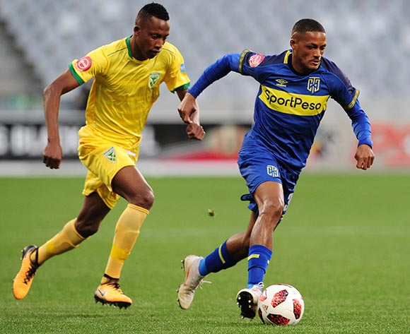 Craig Martin of Cape Town City is chased by Divine Lunga of Golden Arrows during the Absa Premiership 2018/19 game between Cape Town City and Golden Arrows at Cape Town Stadium on 18 August 2018 © Ryan Wilkisky/BackpagePix