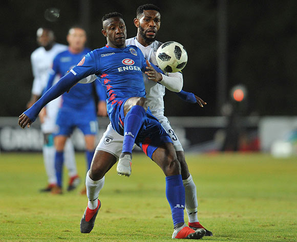 Evans Rusike of Supersport United is challenged by Thulani Hlatshwayo of Bidvest Wits during the Absa Premiership match between Bidvest Wits and Supersport United on the 18 August 2018 at Bidvest Stadium / Pic Sydney Mahlangu/BackpagePix