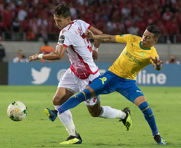 Wydad Athletic Club player Anas El Asbahi(L) and Mamelodi Sundowns le andro sirino  (R) fight for the ball during the CAF Champions League soccer match between Wydad Athletic Club of Morocco and Mamelodi Sundowns of Guinea at Mohamed V Stadium in Casablanca , Morocco,17 August 2018.